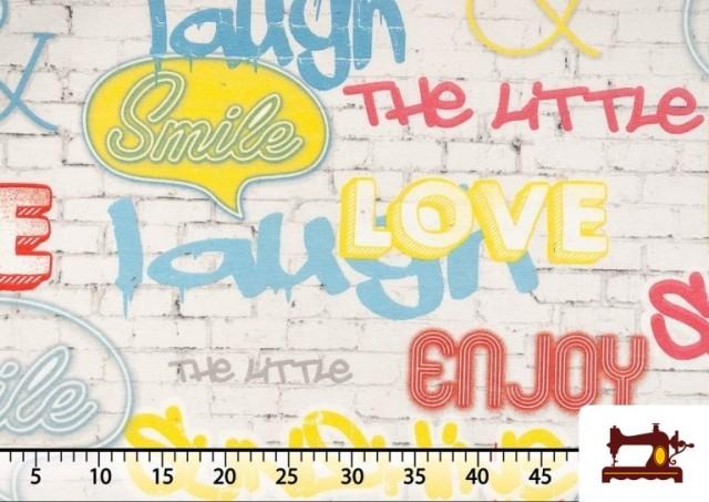 Vente de Tela Estampada con Graffitis en un Muro con Motivos de Felicidad