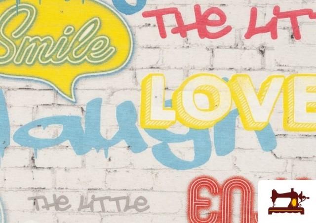 Acheter en ligne Tela Estampada con Graffitis en un Muro con Motivos de Felicidad